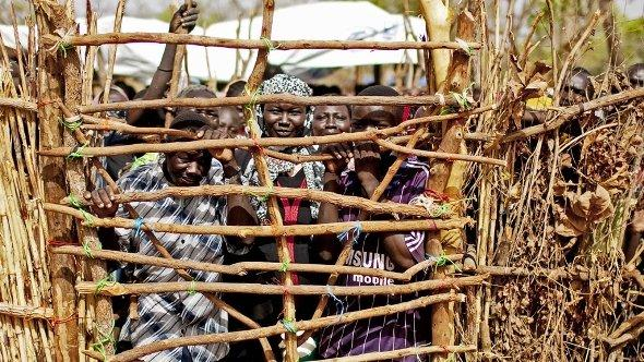 Refugees from South Kordofan, Sudan, await distribution of basic goods in the Yida refugee camp, South Sudan, 12 May 2012. (photo: AP)