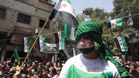 Residents of the Syrian city Yabroud celebrate their liberation by Free Syrian Army units (photo: DW)