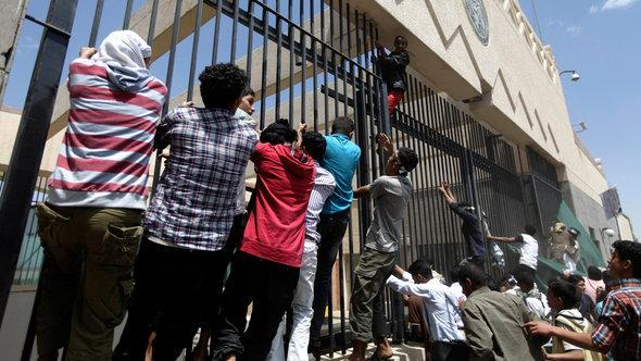 Anti-American protests on the compound of the American embassy in Sanaa, Yemen (photo: Reuters)