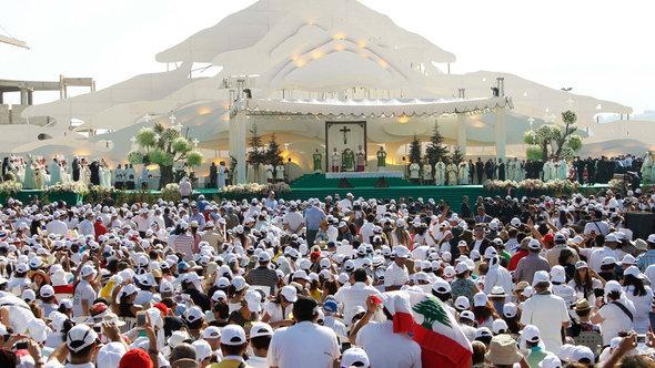 Pope Benedict XVI celebrates mass on a field in Beirut, Lebanon, on 16 September 2012 (photo: Reuters)