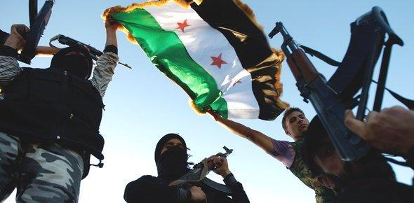 FSA fighters in a suburb of Idlib (photo: AP)