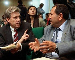 In this Monday, April 11, 2011 file photo, U.S. envoy Chris Stevens, center, accompanied by British envoy Christopher Prentice, left, speaks to Council member for Misrata Dr. Suleiman Fortia, right, at the Tibesty Hotel where an African Union delegation was meeting with opposition leaders in Benghazi, Libya