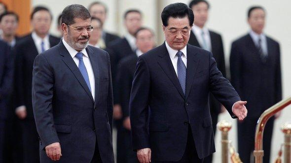 Mohammed Mursi with China's head of state Hu Jintao (photo: Reuters)