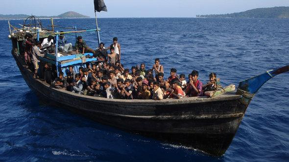 A powerless or engineless boat loaded with Rohingya refugees, moments before it was rescued by Indian Coastguards off Andaman Islands. Thai authorities forced the boatpeople board this boat which was then towed out to the middle of the sea and left to drift with very little food and water (photo: Asiapics)