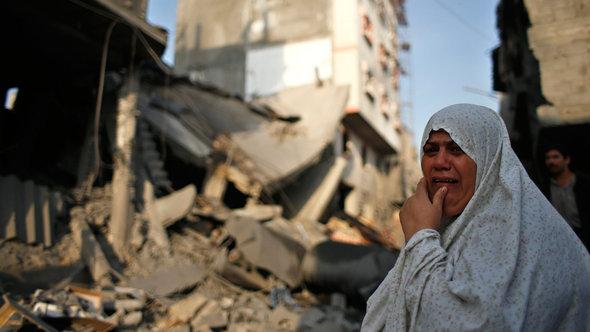 A woman cries in front of the ruins of her home in Gaza City (photo: Reuters)