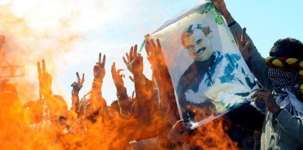 Supporters of the pro-Kurdish Peace and Democracy Party hold a picture of jailed Kurdistan Workers' Party (PKK) leader Abdullah Ocalan as they celebrate the Newroz, the new year, in Istanbul on March 21, 2010