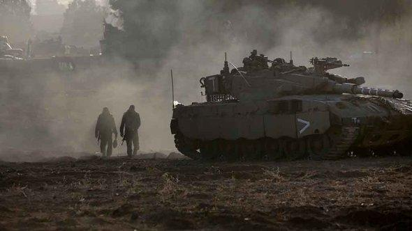 The mobilization of Israeli ground troops on the border with the Gaza Strip (photo: MENAHEM KAHANA/AFP/Getty Images)