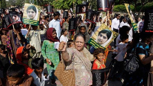 Pakistani students and teachers hold posters of 15-year-old Malala Yousufzai while they take part in a demonstration in Karachi, Pakistan on Saturday, Nov. 10, 2012 (photo: AP)