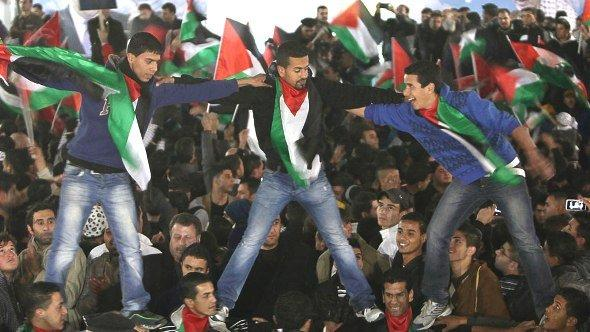 Palestinians celebrate in the West Bank city of Ramallah on 29 November 2012 (photo: AFP/Getty Images)