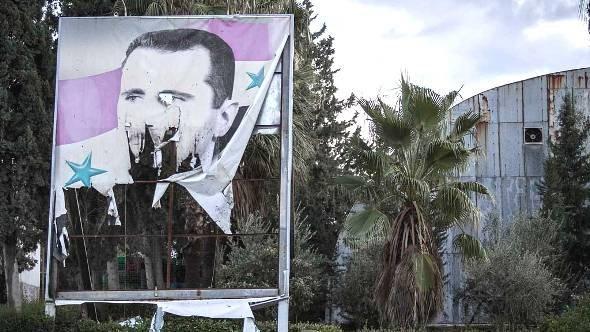 Zerstörtes Assad-Porträtbild in Aleppo; Foto: dapd
