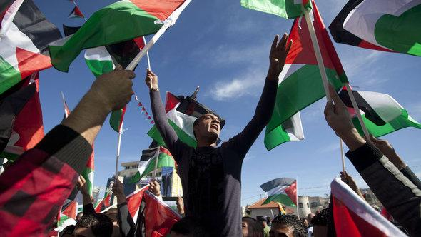 People celebrating on the streets of Ramallah after the resolution was passed by the UN (photo: AFP/Getty Images)