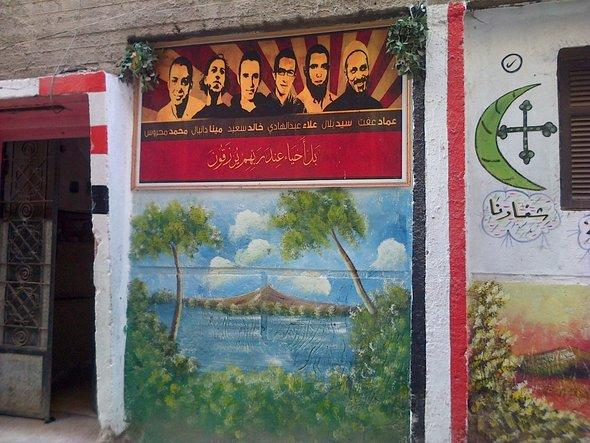 A mural in Mahalla depicting several martyrs of the revolution (photo: Markus Symank)