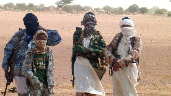Fighters of the Islamic group of Ansar Dine stand in Kidal as Burkina Faso's foreign Minister Djibrille Bassole meets with the Islamic group leader on August 7, 2012 (photo: Getty Images)