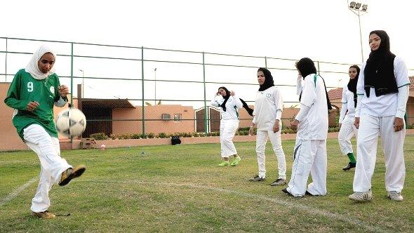 Saudi members of the King's United women football club train at a stadium in the Red sea port of Jeddah on May 20,2009, despite strict religious taboos in the desert kingdom (photo:  Omar Salem/AFP/Getty Images)