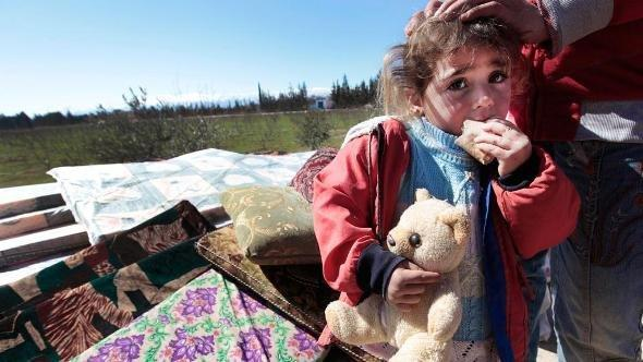 A Syrian child is seen who fled from the Syrian town of Qusair near Homs, at the Lebanese-Syrian border village of Qaa, eastern Lebanon, Monday, March 5, 2012 (photo: Hussein Malla/AP/dapd)