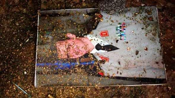 A picture of Syria's President Bashar al-Assad is seen on the ground at the army base at Hawa village, north Aleppo December 23, 2012 (photo: Ahmed Jadallah/Reuters)