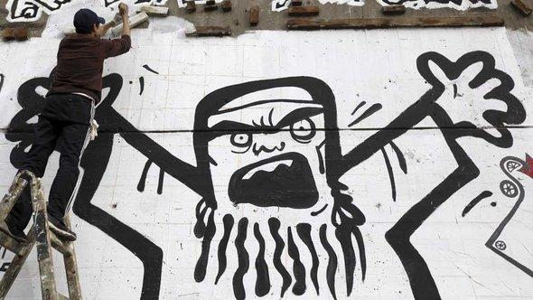 Caricature of a Muslim Brotherhood fanatic on Tahrir Square, Cairo (photo: Reuters)