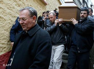 In this Feb. 6, 2006 file photo, catholic priest Luigi Padovese, left, walks in front of the coffin of his slain fellow clergyman Andrea Santoro before a memorial service in the Black Sea city of Trabzon, Turkey (photo: AP)