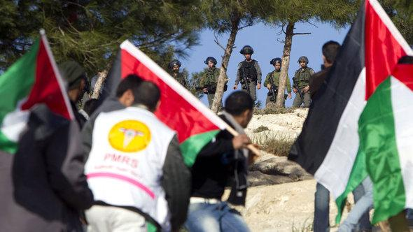Palestinian activists in Bab al-Shams (photo: A. Gharabli/AFP/Getty Images)