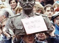 A demonstrator carrying a bust of former Soviet leader Stalin during Czechoslovakia's Velvet Revolution in Prague in 1989 (photo: AP)