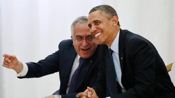 US President Barack Obama watches a cultural event alongside Palestinian Prime Minister Salam Fayyad (photo: Reuters)