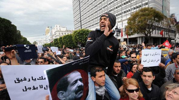 Anti-Ennahda demonstration in Tunis following the murder of opposition politician Chokri Belaid (photo: Fethi Belaid/AFP/Getty Images)