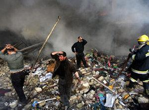 Iraqis grieve amid the rubble after a double car bomb attack in central Baghdad, on 12 February 2007 (photo: AP/Khalid Mohammed)