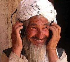 Afghan farmer with headphones (photo: Afghan Eyes)