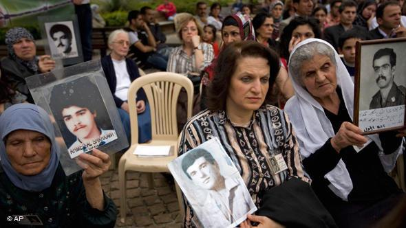 Lebanese women hold pictures of their relatives disappeared in the war (photo: AP)