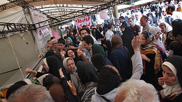 Iranians queuing for subsidised food in Tehran (photo: Mehr)