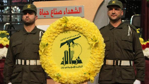 Two militiamen taking part in a Hezbollah parade in Beirut, Lebanon (photo: AFP/Reuters)