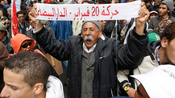 Anti-government protesters from the 20th February movement calling for the fall of the government in Rabat on 31 March 2013 (photo: AP/Abdeljalil Bounhar)