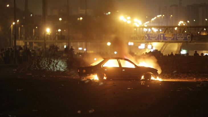 Street battle in Nasr City on 27 July 2013 (photo: Reuters)
