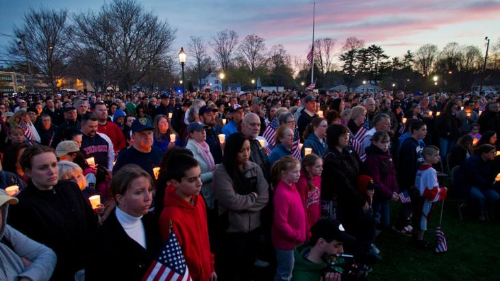 People hold candles during a vigil for slain MIT police officer Sean Collier at the Town Common in Wilmington, Massachusetts, 20 April 2013 (photo: Reuters)