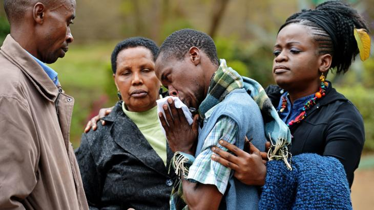 A man mourns the death of his father in the Westgate attack (photo: AFP/Getty Images)