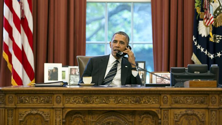 Barack Obama on the phone in the Oval Office talking to Iran's President Rouhani (photo: rtr)
