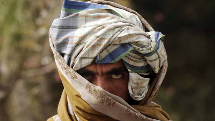 A former Taliban fighter looks on after joining Afghan government forces during a ceremony in Herat province on March 26, 2012 (photo: AP)