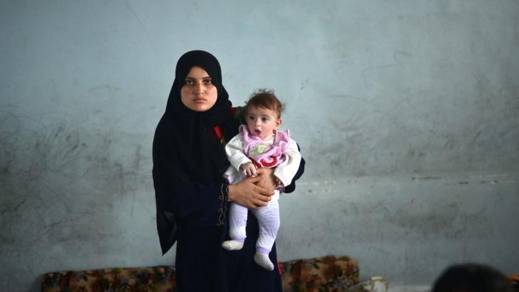Mother with baby, refugees from Aleppo (photo: Dimitar Dilkoff/AFP/Getty Images)