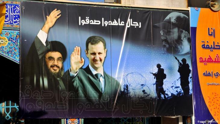 Plakat am schiitischen Wallfahrtsort Sayyida Zainab bei Damaskus; Foto: picture alliance/ZB