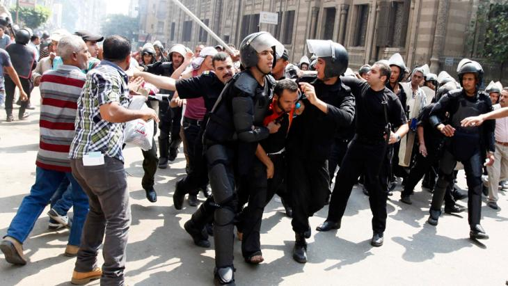 Police detain a supporter of ousted Egyptian President Mohamed Mursi during clashes in central Cairo August 13, 2013 (photo: Mohamed Abd El Ghany / Reuters)