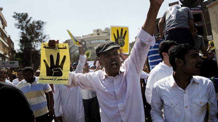 Supporters of the Muslim Brotherhood demonstrate at the Rabaa al-Adawiya protest camps in Cairo (photo: Gianluigi Guercia/AFP/Getty Images)