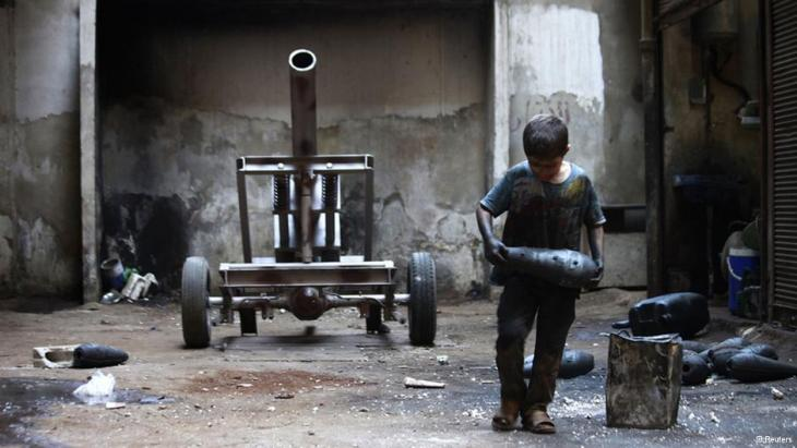 A Syrian child plays with ammunition (photo: Reuters)