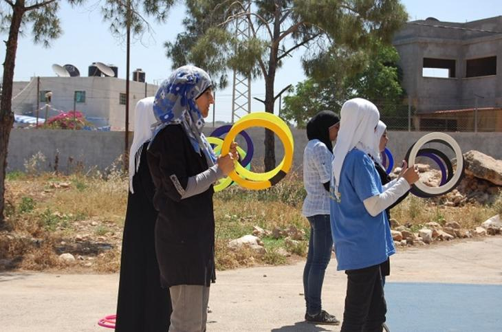 A group of girls learning to juggle with hoops (photo: Palestinian Circus School)