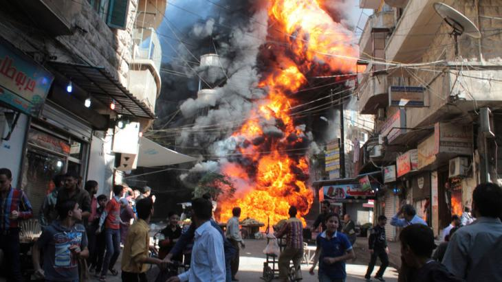 A bomb explodes in a residential area of Aleppo (photo: Reuters)