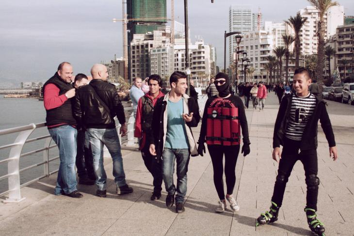 Artist Rima Najdi walks along Beirut's Corniche wearing a fake explosive belt on 12 January 2014 (photo: Maria Kassab)