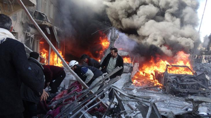 The city of Aleppo after being hit by barrel bombs dropped by the Syrian Air Force (photo: Getty Images)