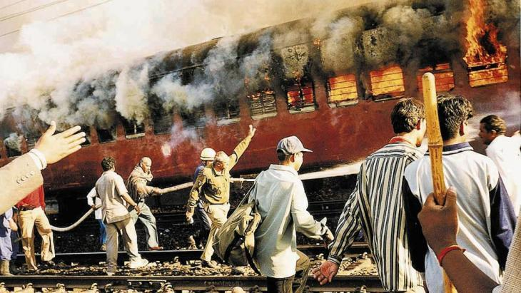 A burning train in Godhra railway station in February 2002 (photo: AP)