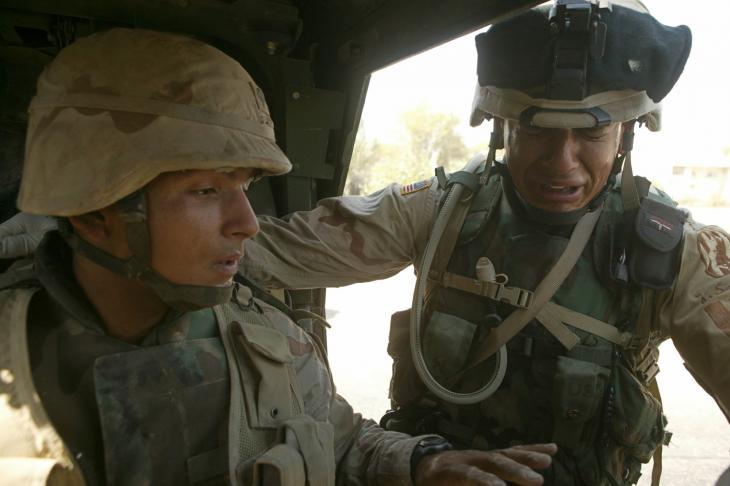 Two brothers break down in tears following a roadside bomb attack, 5 June 2004, Sadr City, Baghdad, Iraq (photo: Michael Kamber)