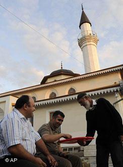 Crimean Tatars outside a mosque in Simferopol (photo: AP)