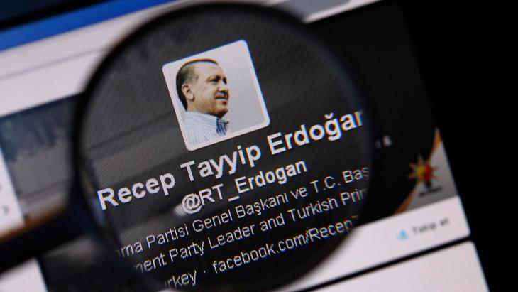 An image of Turkish Prime Minister Tayyip Erdogan on a twitter account page viewed through a magnifying glass (photo: Reuters)